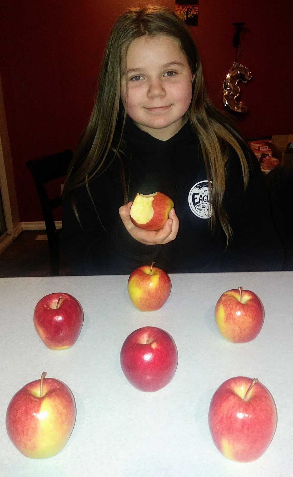 my daughter sage enjoying ambrosia apples