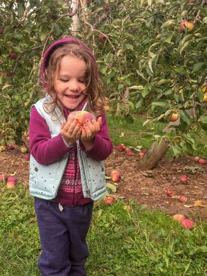 so proud of the apple she picked herself